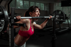 Beautiful sports fitness girl with a barbell Royalty Free Stock Images