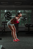 Beautiful sports fitness girl with a barbell Royalty Free Stock Photos