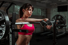 Beautiful sports fitness girl with a barbell Stock Images