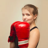 Beautiful sports girl with boxing gloves Royalty Free Stock Photo