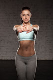 Beautiful sports girl do her workout, abs, abdominals, training in the gym. Beautiful sports girl do her workout, abs, abdominals training in the gym Stock Photos