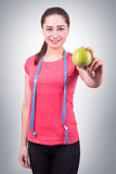 Beautiful sports girl holding an apple Stock Image