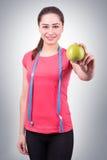 Beautiful sports girl holding an apple Stock Image