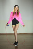 Beautiful sports girl. Beautiful young slender girl with a skipping rope in her arms during training Stock Images