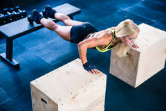 Beautiful sports woman doing push ups on fit box Royalty Free Stock Photos