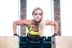 Beautiful sports woman doing push ups on fit box Stock Photo
