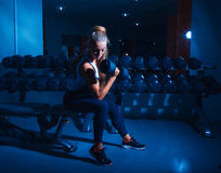 Beautiful sports woman with dumbbell in gym Royalty Free Stock Photography