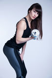Beautiful sports woman with strong legs Stock Photography