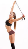 Beautiful sportsgirl with skipping rope Royalty Free Stock Photography