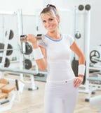 Beautiful sportswoman holding  dumbbell Royalty Free Stock Image