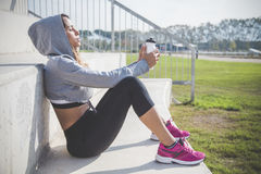 Beautiful sportswoman resting after an exercise session. Portrait of beautiful sportswoman sunbathing Stock Photography