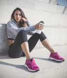 Beautiful sportswoman resting after an exercise session Stock Photo