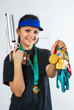 Beautiful sportswoman on shooting. Making look younger sportswoman after competitions Stock Image