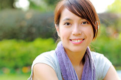 Beautiful sporty asian girl. Smiling Royalty Free Stock Image