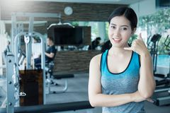 Beautiful sporty asian woman with her hand as a phone Royalty Free Stock Photo