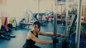 Beautiful sporty brunette Woman middle aged working out doing squats. 4 k stock video