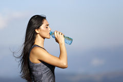 A beautiful sporty caucasian girl drinking water Stock Images