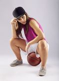 Beautiful and sporty female basketball player Royalty Free Stock Images