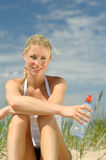 Beautiful sporty female on the beach Royalty Free Stock Photos