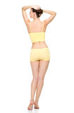 Beautiful sporty female body in yellow underwear stock photography