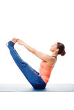 Beautiful sporty fit woman practices yoga asana Ubhaya padangust Stock Images