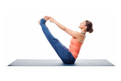 Beautiful sporty fit woman practices yoga asana Royalty Free Stock Photography