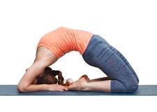 Beautiful sporty fit yogi girl practices yoga asana Kapotasana Royalty Free Stock Photography