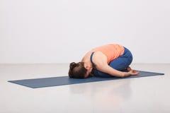 Beautiful sporty fit yogi girl practices yoga Stock Image