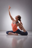 Beautiful sporty fit yogi girl practices yoga royalty free stock image