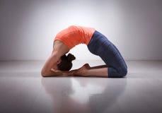 Beautiful sporty fit yogi girl practices yoga Stock Photos