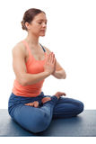 Beautiful sporty fit yogini woman meditates in Stock Photography