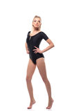 Beautiful sporty girl in black leotard Stock Photos