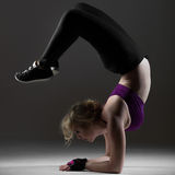 Beautiful sporty girl doing backbend on forearms Stock Images