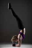 Beautiful sporty girl doing handstand royalty free stock image