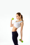 Beautiful sporty girl with dumbbells isolated Royalty Free Stock Images