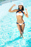 Beautiful and sporty girl relaxing in a swimming pool Royalty Free Stock Photos
