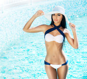 Beautiful and sporty girl in a swimsuit near a pool Royalty Free Stock Photos