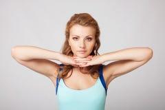 Beautiful sporty lady doing exercise Stock Photo