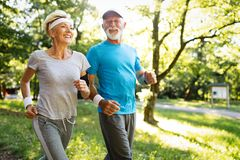 Beautiful sporty mature couple styaing fit with sport royalty free stock photo