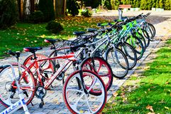 Beautiful sporty mountain multicolored bicycles for recreation and sport are parked in a row . Belarus, Minsk, September 12, 2018 stock images