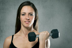 Beautiful sporty muscular woman with dumbbell Royalty Free Stock Photography