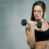 Beautiful sporty muscular woman with dumbbell Royalty Free Stock Photo