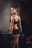 Beautiful sporty muscular woman workout in the gym Royalty Free Stock Photo