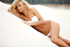 Beautiful, sporty and woman lying on the beach Royalty Free Stock Images
