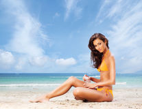 Beautiful, sporty and sexy woman relaxing on the beach Royalty Free Stock Photo