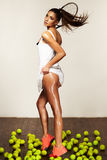 Beautiful sporty sexy woman, tennis player with racket Royalty Free Stock Photography