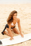 Beautiful sporty surfer girl at the beach. Royalty Free Stock Photos