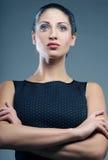 Beautiful sporty woman in black dress Stock Image