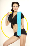 Beautiful sporty woman in black dress slim body with hula hoop Royalty Free Stock Image