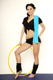 Beautiful sporty woman in black dress slim body with hula hoop Stock Images